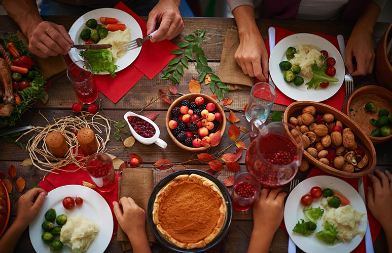festive table and people eating