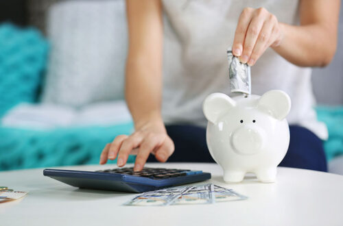 woman saving money piggy-bank